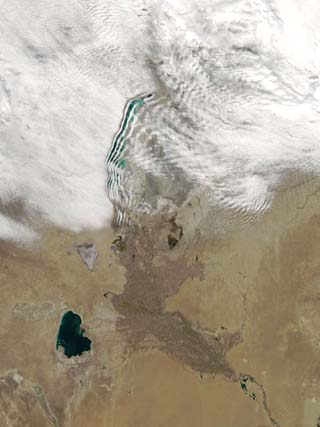 Distinctive Lines of Clouds Stretch Out from the Shore of the Aral Sea