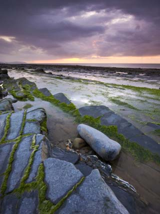Stormy Sunset over Bristol Channel, Viewed from Rocky Shores of Kilve Beach, Somerset, England