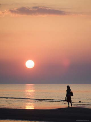 Girl Walking Barefoot on Beach at Sunset, Jurmala Beach Resort, Gulf of Riga, Latvia