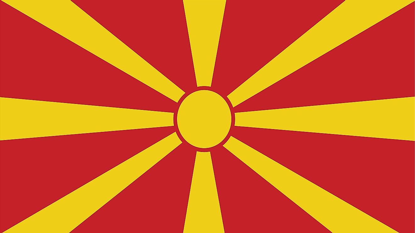 The national flag of Macedonia consists of stylized yellow sun centered on red field with its eight broadening yellow rays extending out in all directions and end at the edges of the flag