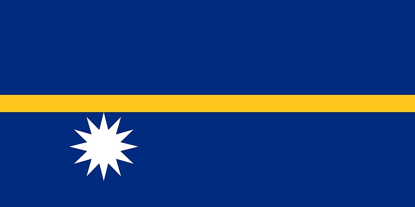 The National Flag of Nauru features a blue background with a narrow, horizontal gold stripe and a white star in the lower hoist side