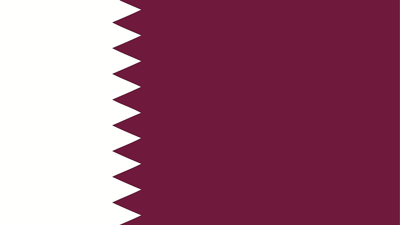 The National Flag of Qatar features a wider maroon band on the fly side, with a broad white serrated band (nine white points) on the hoist side of the flag.