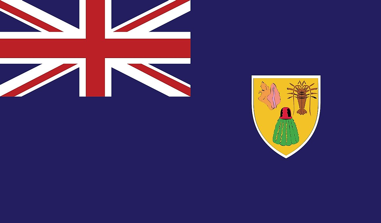 The Flag of Turks and Caicos Islands features a blue background with the flag of the United Kingdom (Union Jack) in the upper hoist-side quadrant and the colonial shield centered on the outer half of the flag.