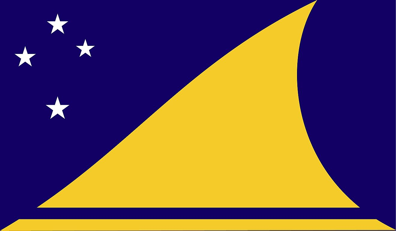 The flag of Tokelau showing a yellow canoe sailing towards the Southern Cross in a deep blue background.