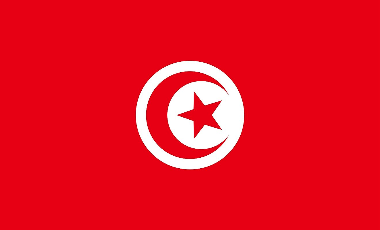 The National Flag of Tunisia is rectangular in shape and features a red background with a white disk at the center, that bears a red crescent nearly encircling a red five-pointed star.