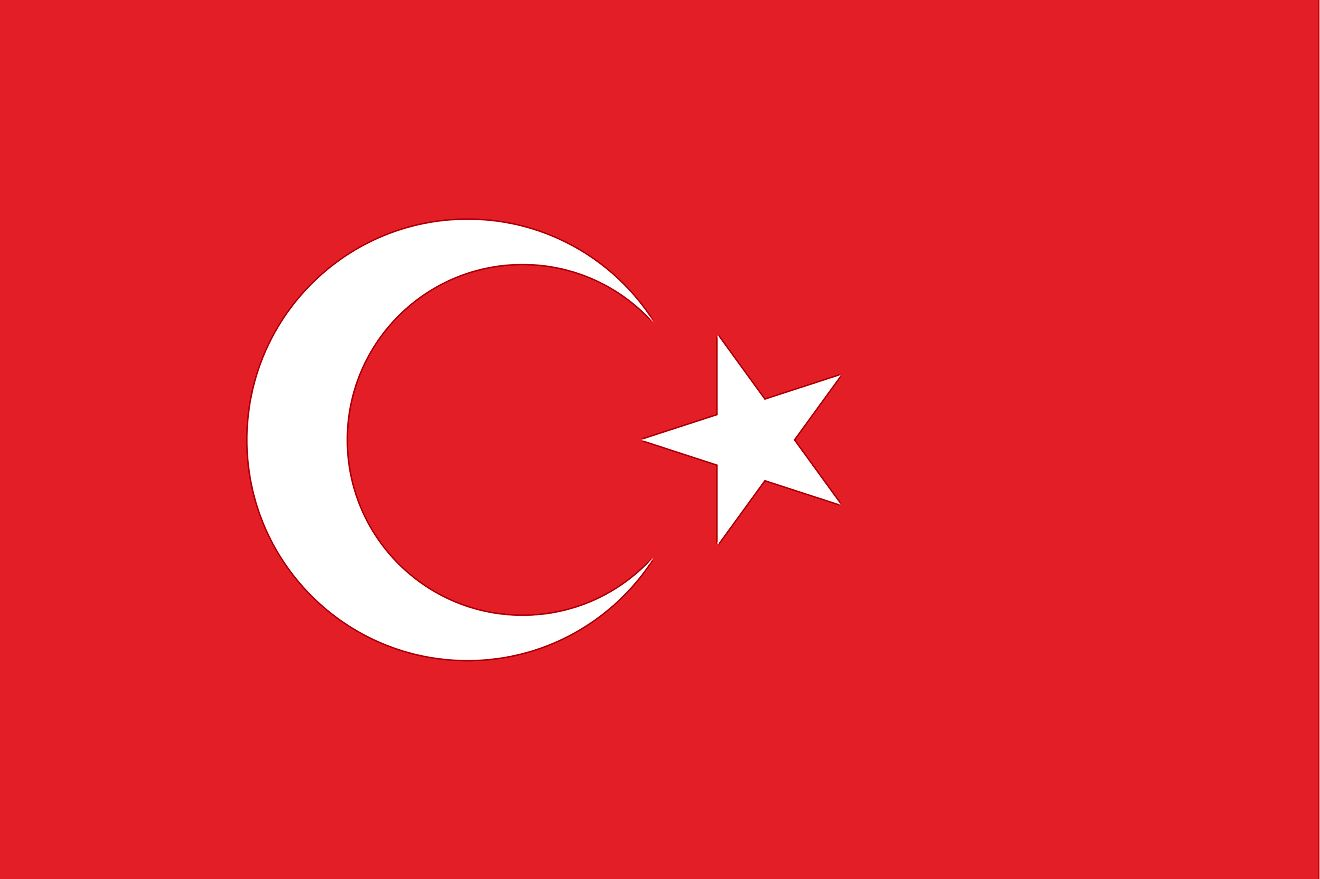 The National Flag of Turkey features a red background with a vertical white crescent moon (the closed portion of which is towards the hoist side) and a white five-pointed star centered just outside the crescent opening; both of which are placed slightly t
