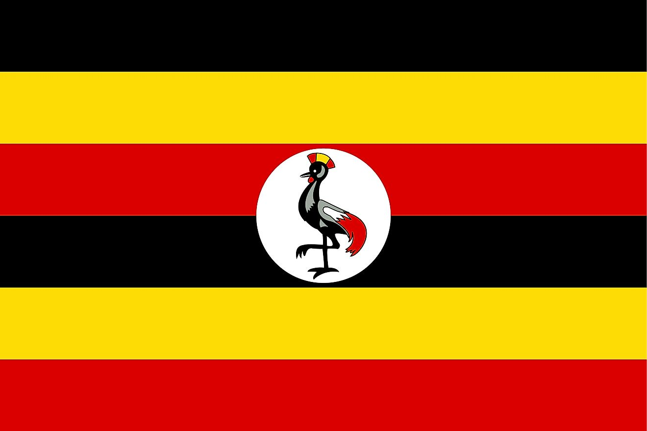 The National Flag of Uganda features six equal horizontal bands of black (top), yellow, red, black, yellow, and red. The flag also includes a white disc superimposed at the center, which is featuring a grey-crowned crane, facing the hoist side of the flag