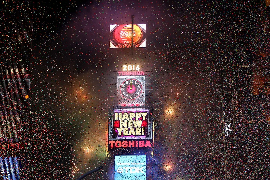 Confetti fills the air as crowds celebrate the annual New Year's Eve Ball Drop in New York City's Times Square. Editorial credit: Debby Wong / Shutterstock.com.