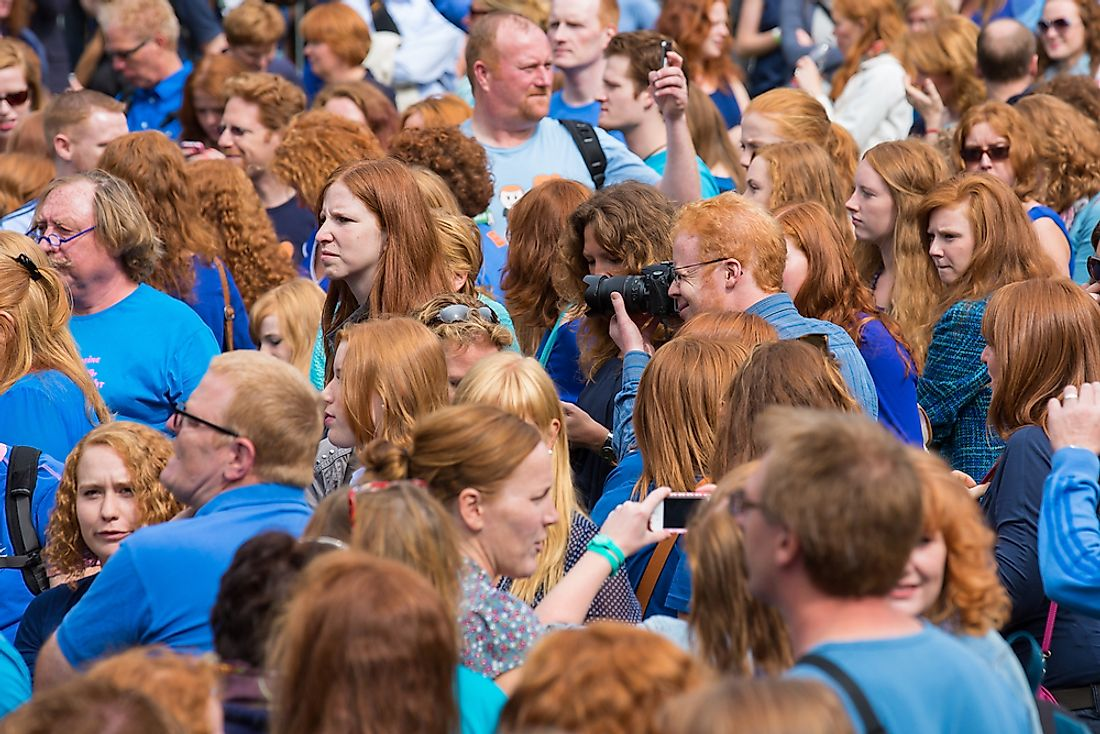 "A crowd of people seen during ""red head day"" in the Netherlands. Editorial credit: Rob van Esch / Shutterstock.com."