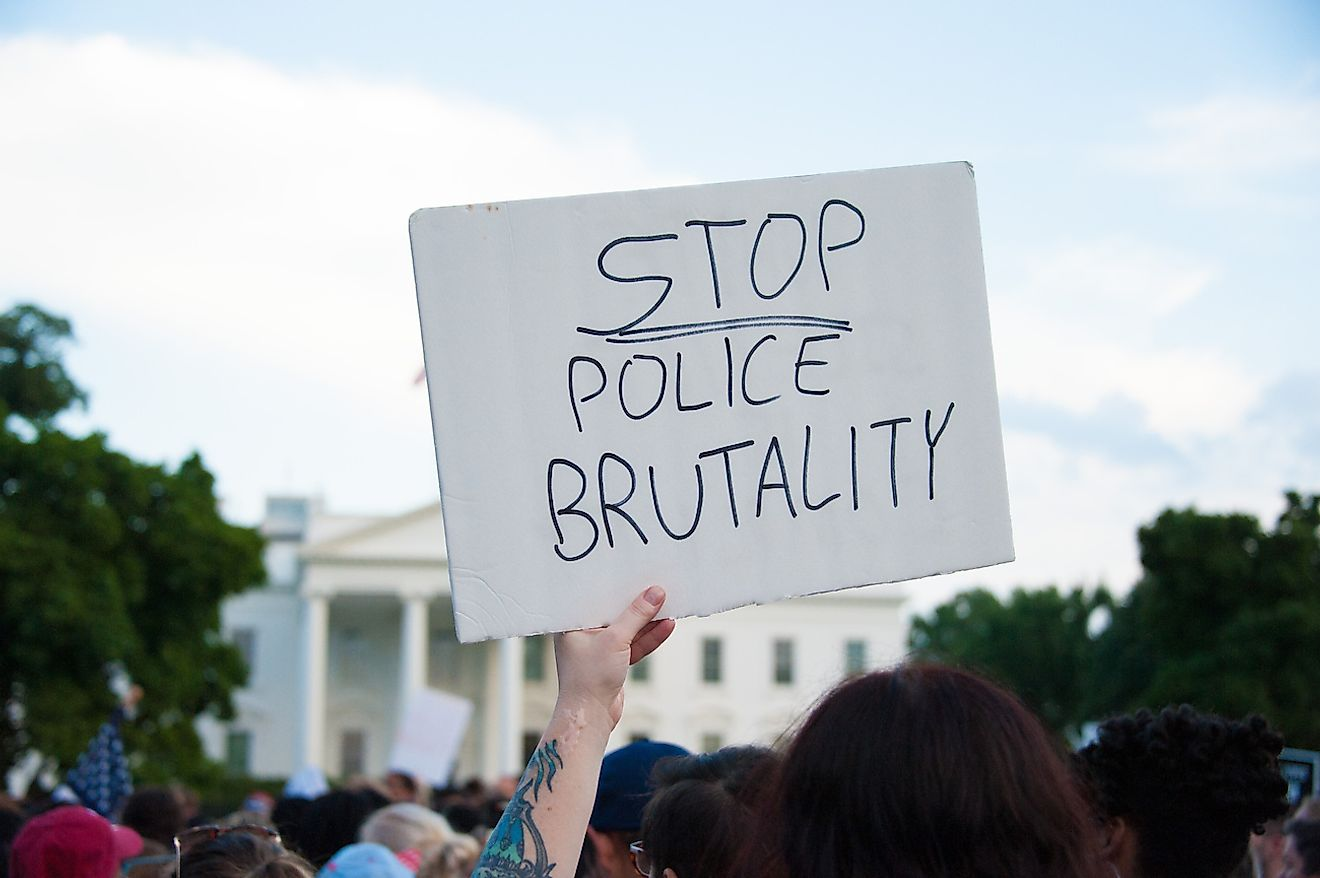 A sign held at a march against police brutality and racism in front of the White House in Washington, DC on July 7, 2016. Image credit: Rena Schild/Shutterstock.com