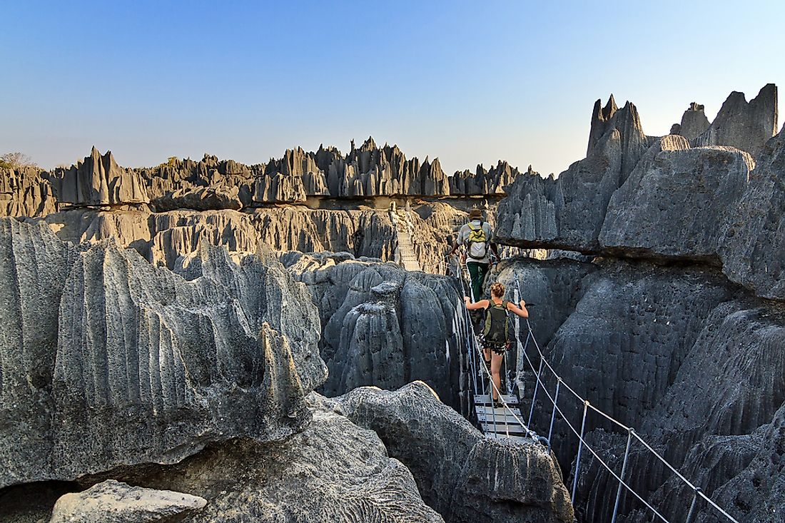 Tourists explore the beautiful limestone landscape of the Tsingy de Bemaraha Strict Nature Reserve, Madagascar.
