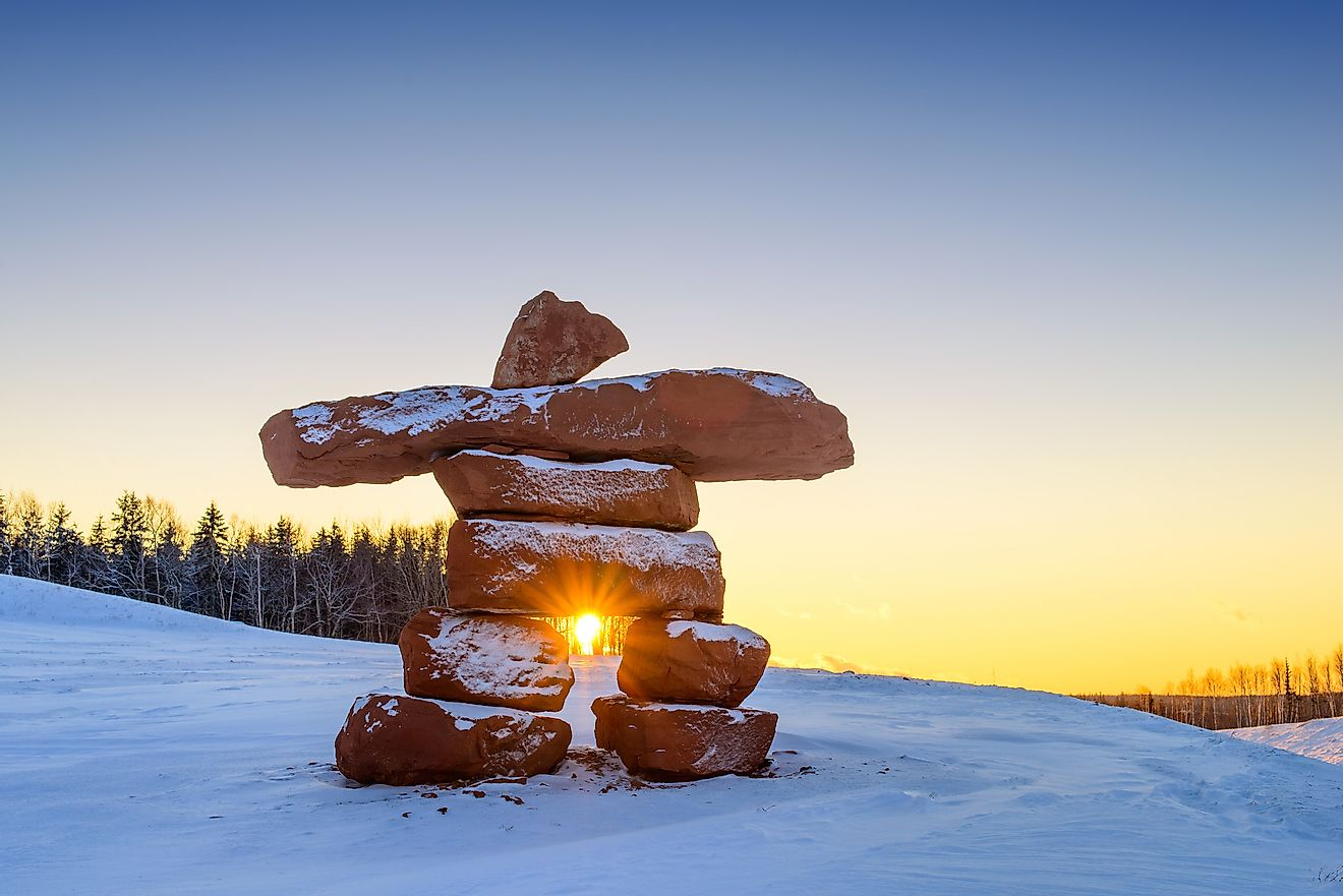 Inukshuk with dusting of snow at sunset. Image credit: Smcfeeters/Shutterstock.com