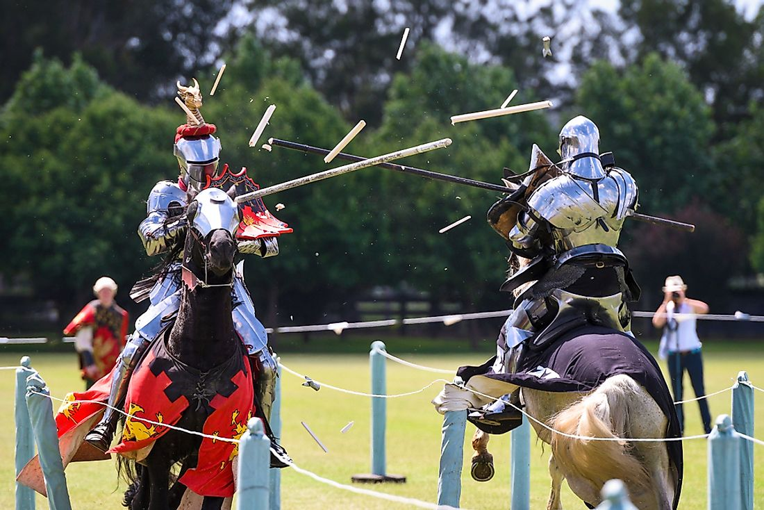 Men dressed up as knights compete in jousting.