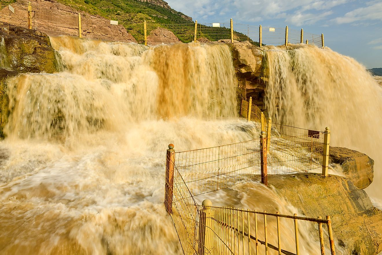 The Hukou Waterfall along China's Yellow River is the world's largest yellow waterfall.