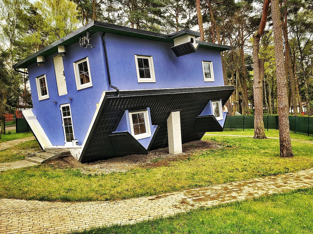 Upside-down houses often make visitors feel dizzy and disoriented. Editorial credit: Fotokon / Shutterstock.com