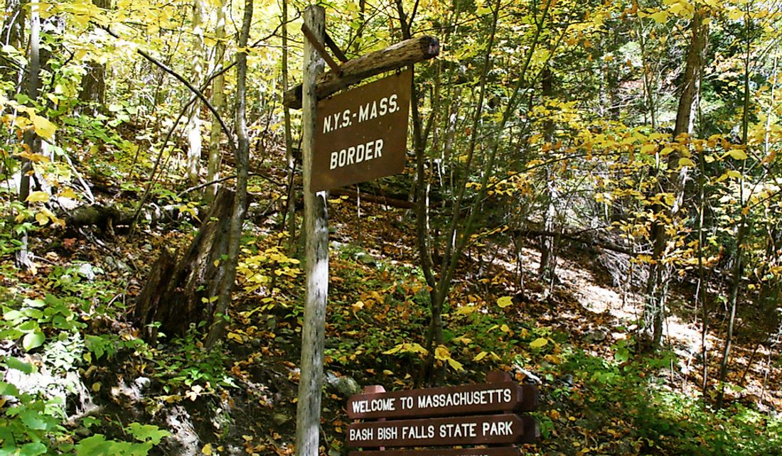 New York-Massachusetts border sign in Bish Bash Falls Lake Park.