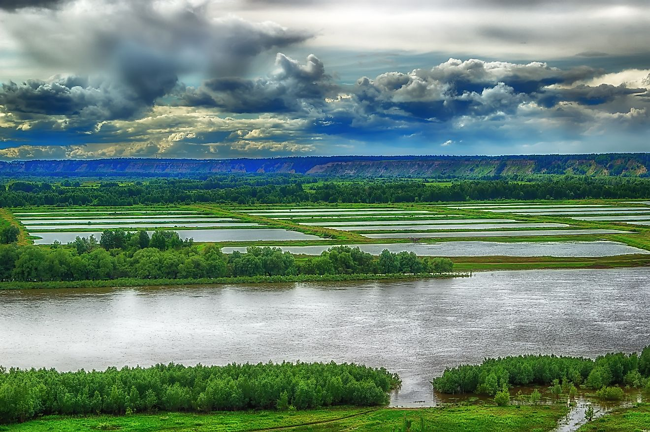 Fertile fields and artificial ponds lie along the Irtysh in Siberia.