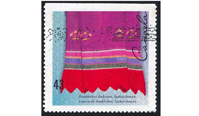 A Canadian stamp showing the Doukhobor bedspread pattern.  Editorial credit: rook76 / Shutterstock.com.