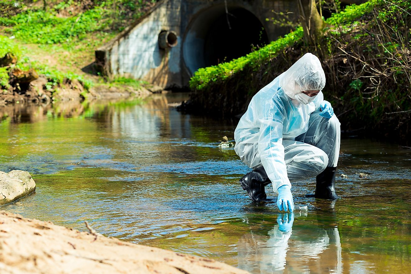 A researcher collecting sample of contaminated water for inspection of its quality in the lab. Image credit: kosmos111/Shutterstock.com