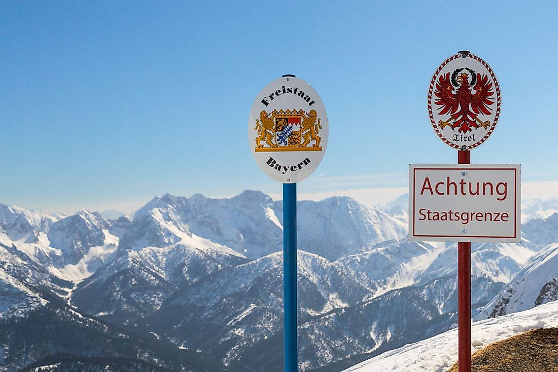 Signs marking the boundary between Bavaria in Germany and Tyrol in Austria.