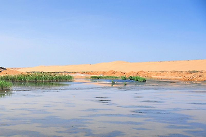 The tidal water of the Atlantic Ocean meet the desert in the Laayoune are of the northwestern Western Sahara.