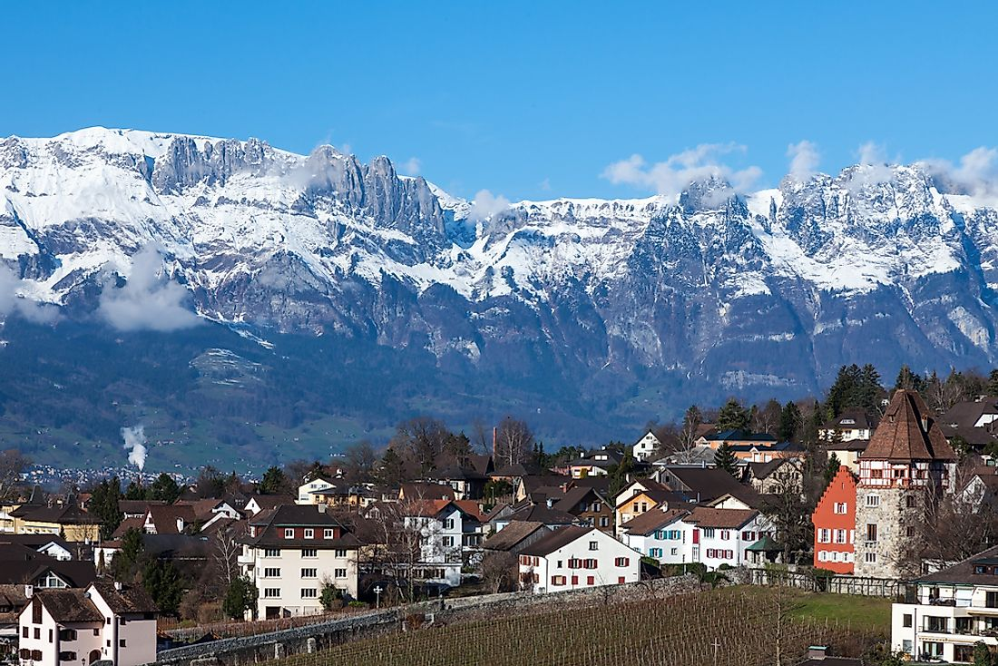 Vaduz, the capital city of Liechtenstein, sits between the Rhine River and the Alps.