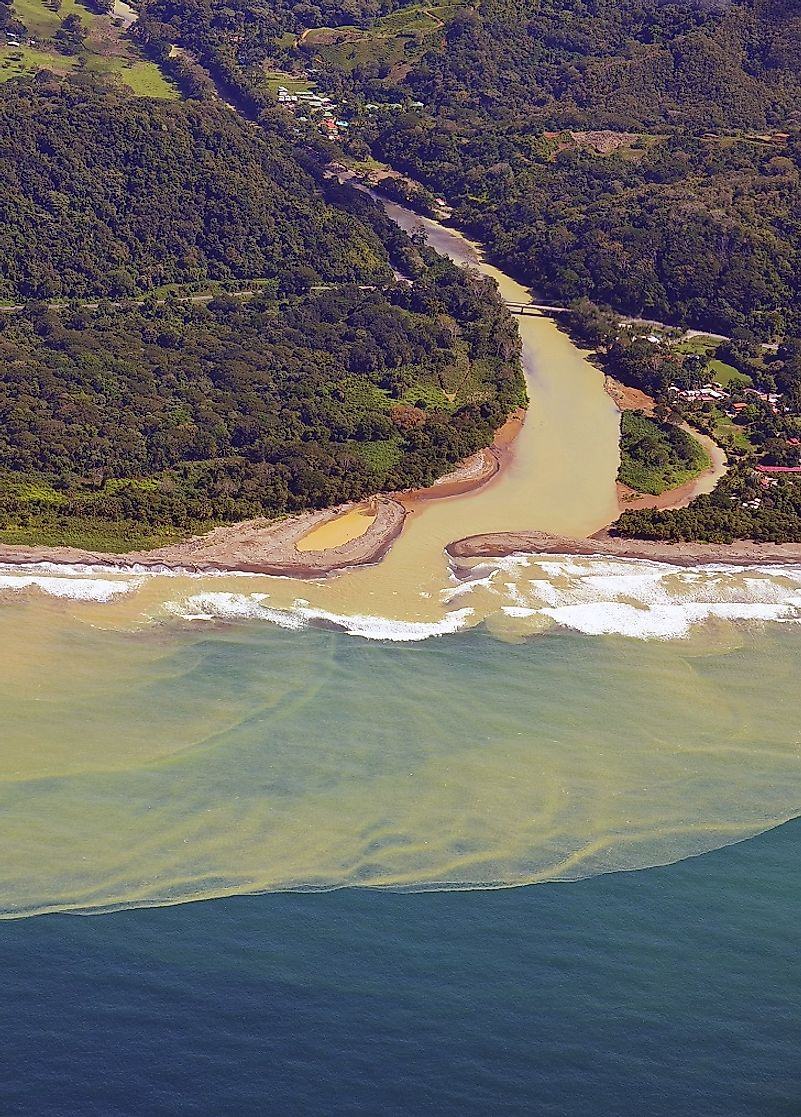 A Costa Rican river discharging massive amounts of its silt-laden waters (caused by erosion) into the ocean.