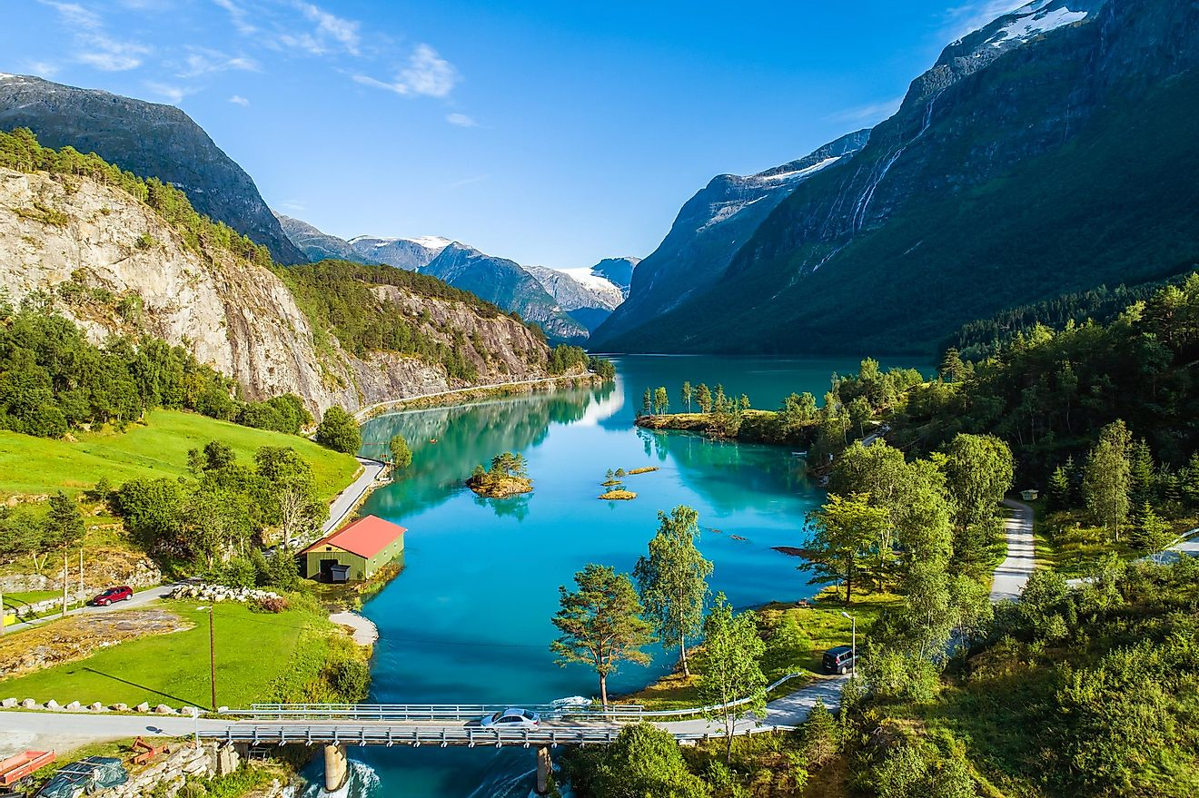 Aerial summer view of bridge and boathouse on bank of greenest lake in Norway - Lovatnet