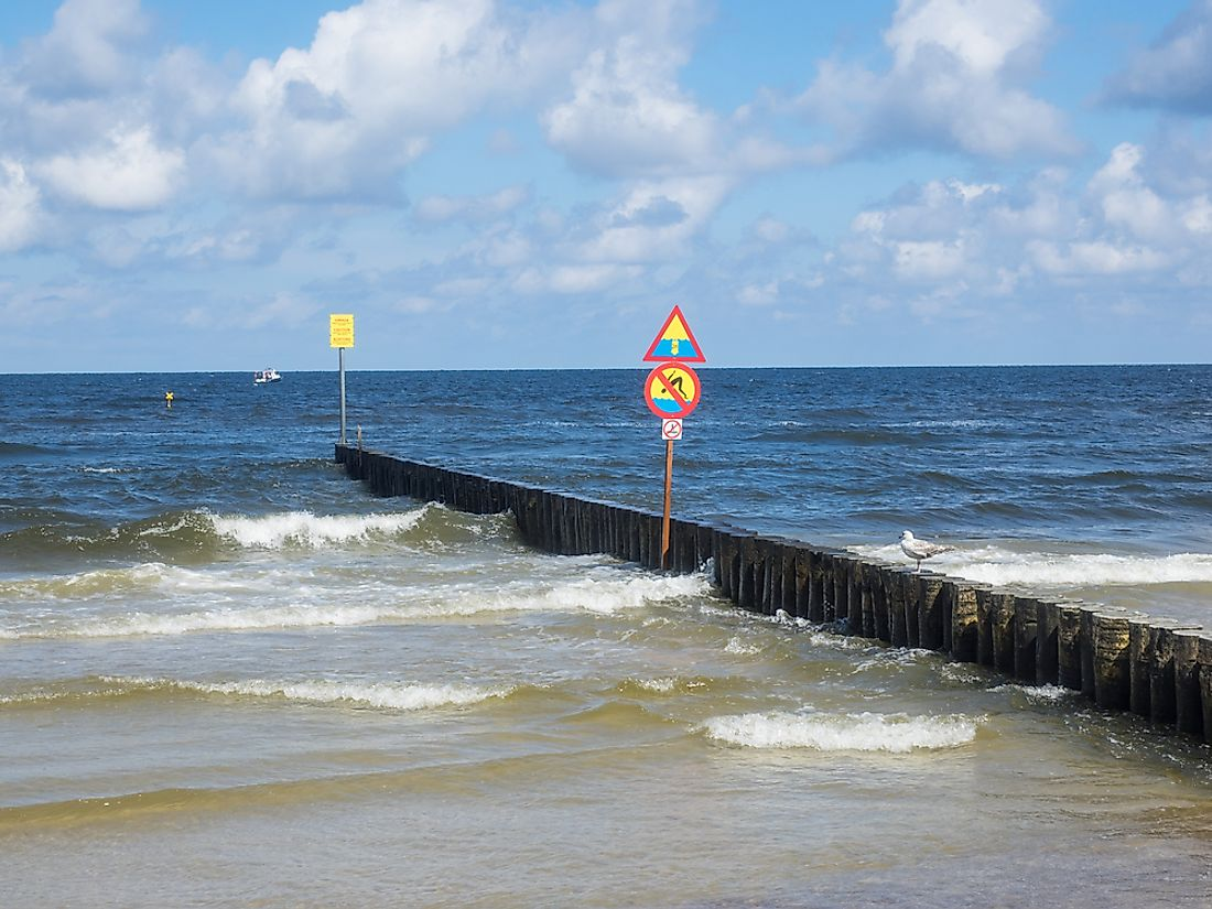 The purpose of a breakwater is to protect against the effects of processes such as longshore drift.