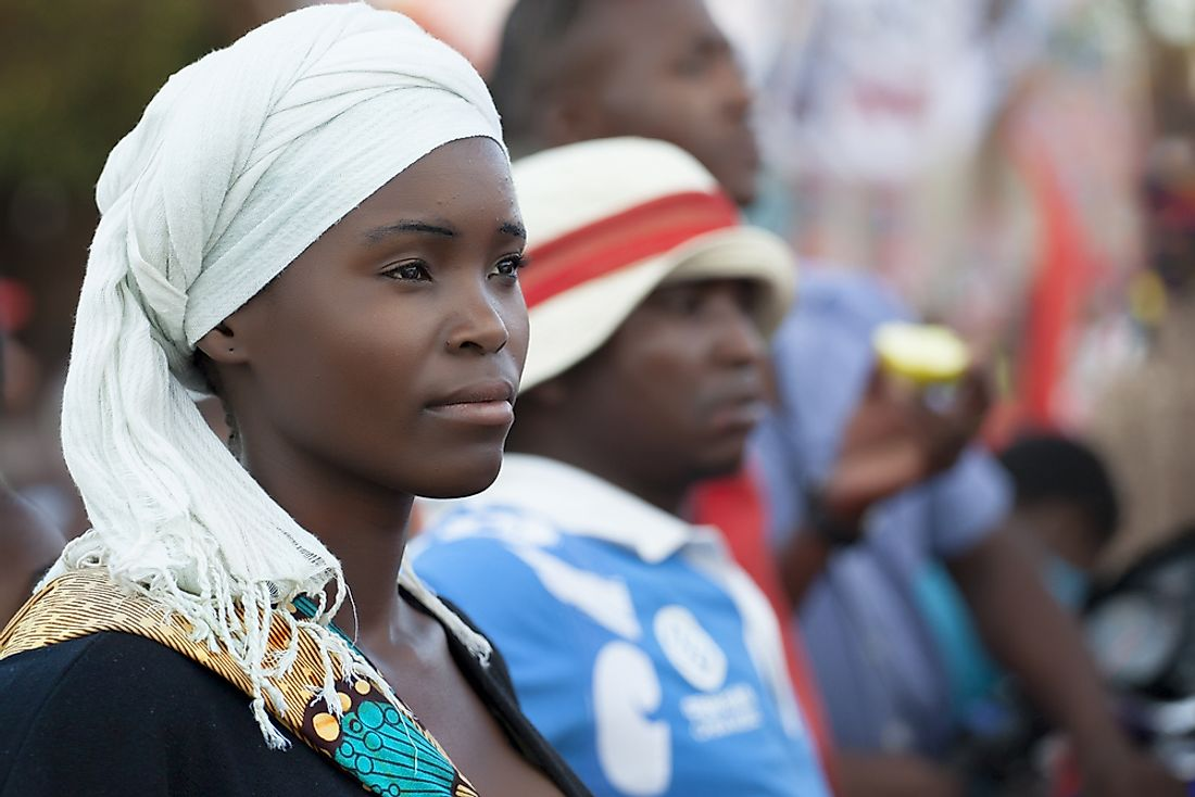 A young woman from Mozambique wearing a traditional scarf. Editorial credit: gaborbasch / Shutterstock.com.