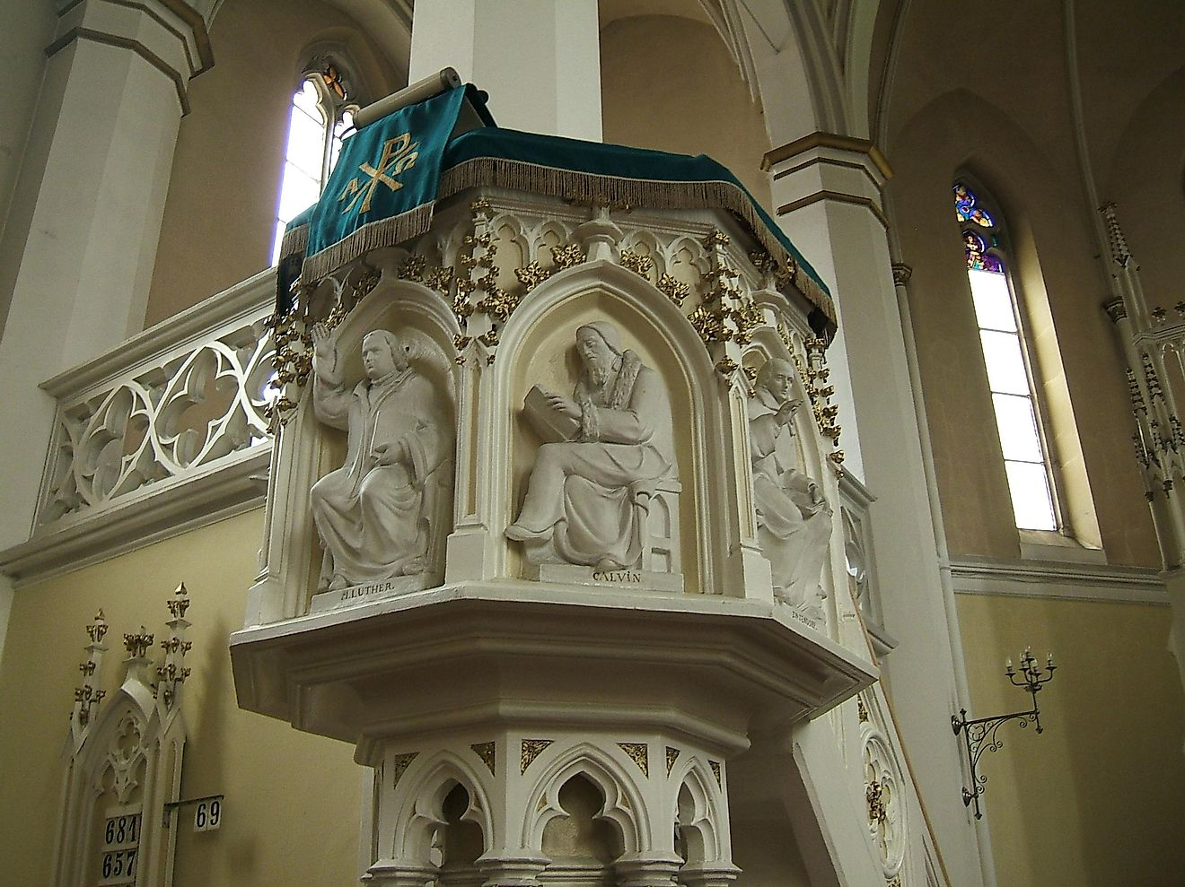 Martin Luther and John Calvin, key proponents of the Protestant Reformation are depicted on a church pulpit.