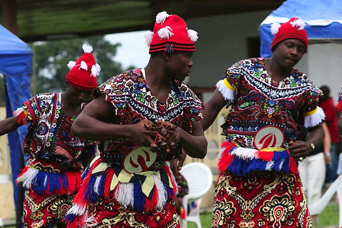 Igbo men perform a traditional dance. Editorial credit: Lorimer Images / Shutterstock.com.