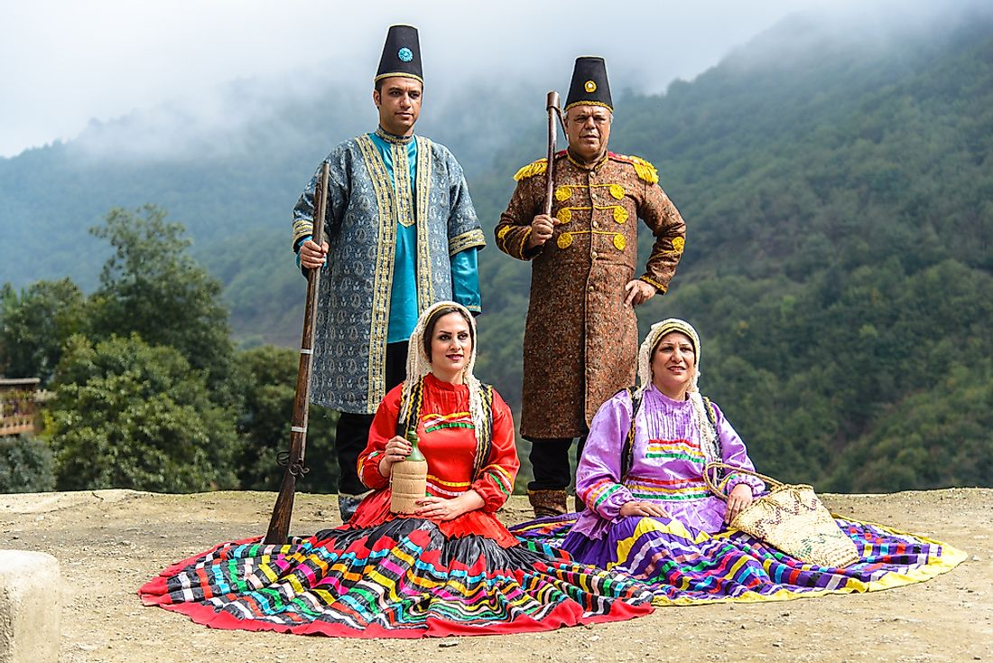 Men and women wear traditional clothing during Eid al-Adha celebrations. Editorial credit: Jakob Fischer / Shutterstock.com.