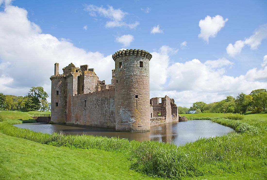The moated Caerlaverock Castle in Scotland was built in the 13th century.