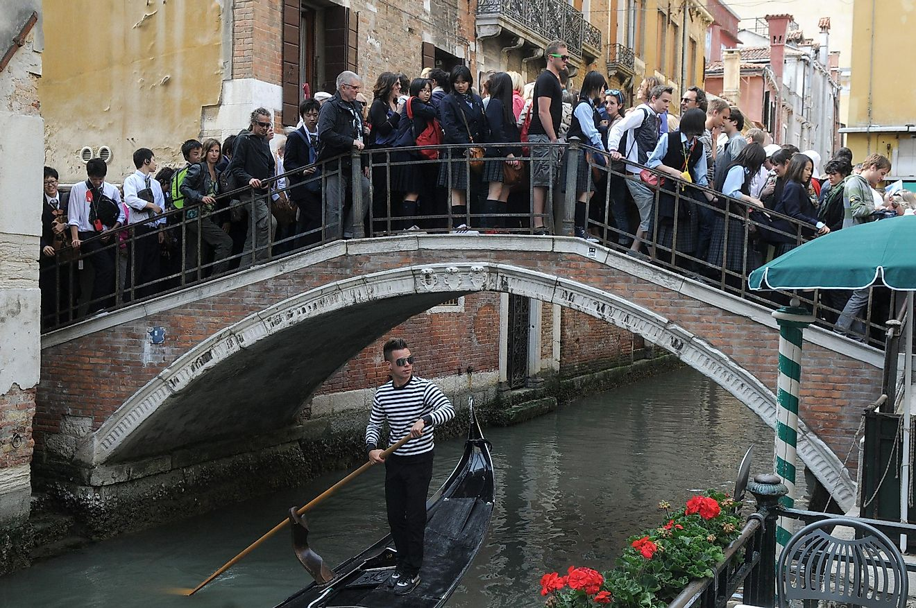 A bridge in Venice overcrowded with tourists.