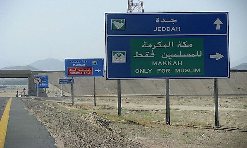 Road signs in Saudi Arabia in Arabic and English.