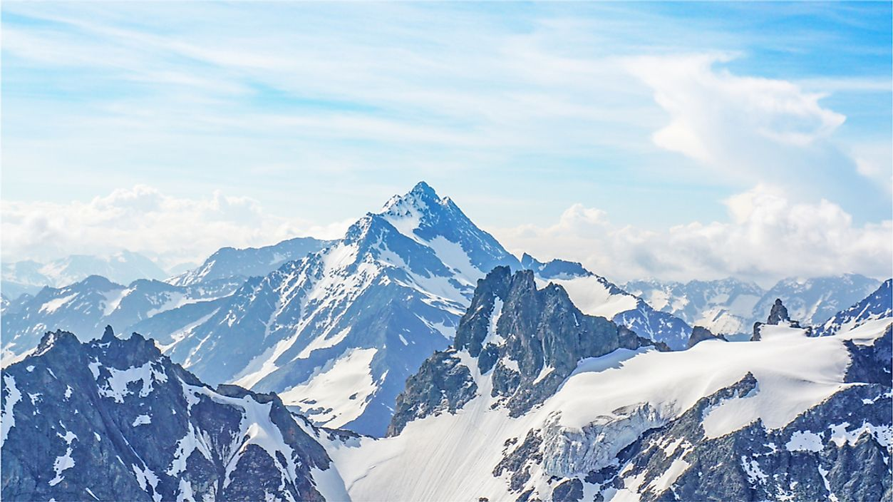 Mountains, such as the Alps, are typically higher in elevation and have a more defined peaks than hills.