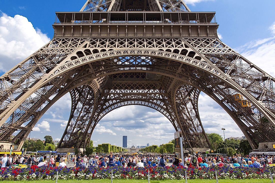 Tourists flock to the Eiffel Tower  in Paris, France. Editorial credit: lapas77 / Shutterstock.com