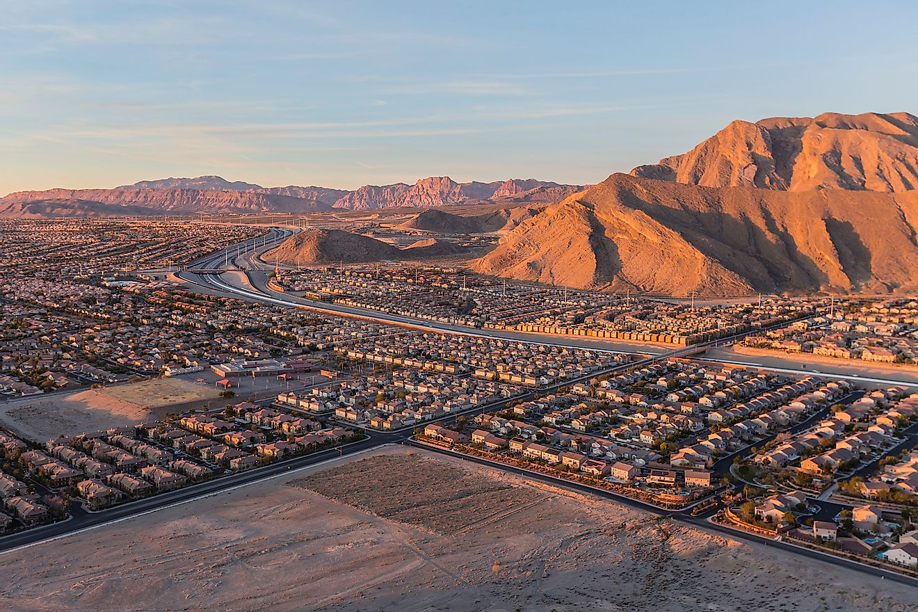 Early morning view of new neighborhoods and Route 215 from the top of Lone Mountain in Northwest Las Vegas. Image credit: trekandshoot/Shutterstock.com