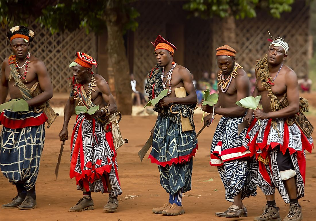 Men perform a traditional dance in the Babungo Kingdom of Cameroon. Editorial credit: akturer / Shutterstock.com.