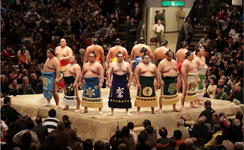 High rank sumo wrestlers line up with crowd in the Tokyo Grand Sumo Tournament. Editorial credit: J. Henning Buchholz / Shutterstock.com