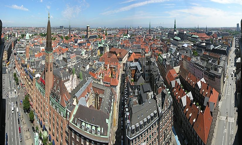 The city skyline of Copenhagen features many towers and spires.