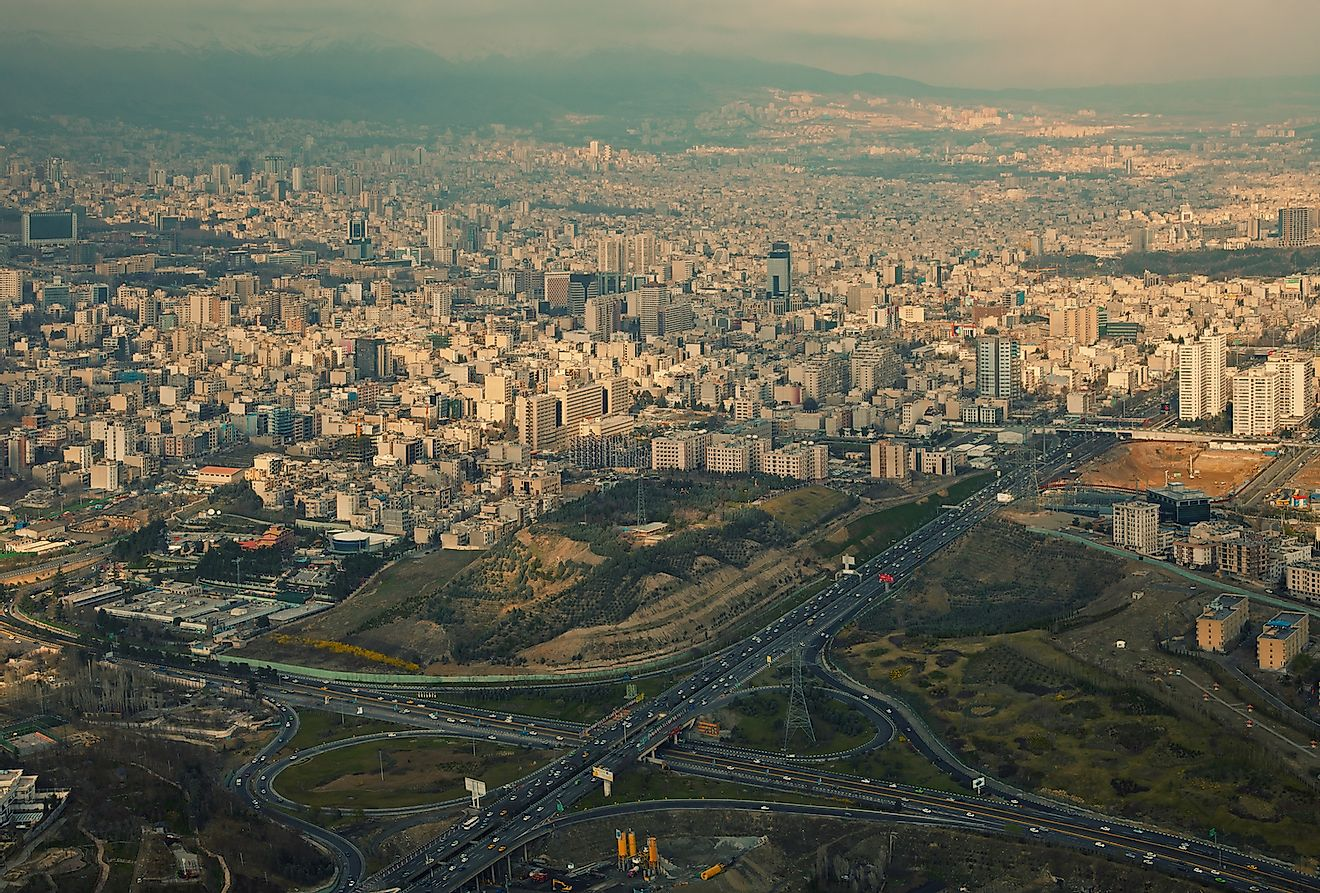 Aerial view of Tehran in a rainy day with ray of sunlight shining through clouds on the city. Image credit:  Borna_Mirahmadian/Shutterstock.com