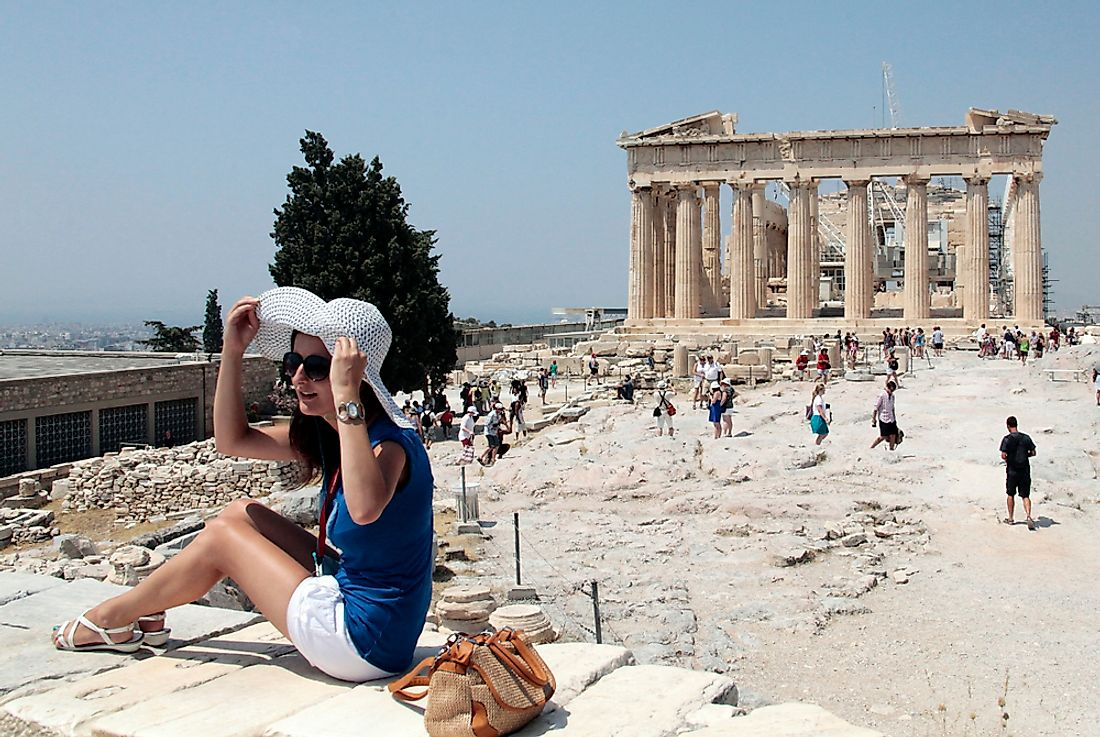Tourists brave the heat to view the Acropolis in Athens, Greece, Europe's hottest city. Editorial credit: Alexandros Michailidis / Shutterstock.com.