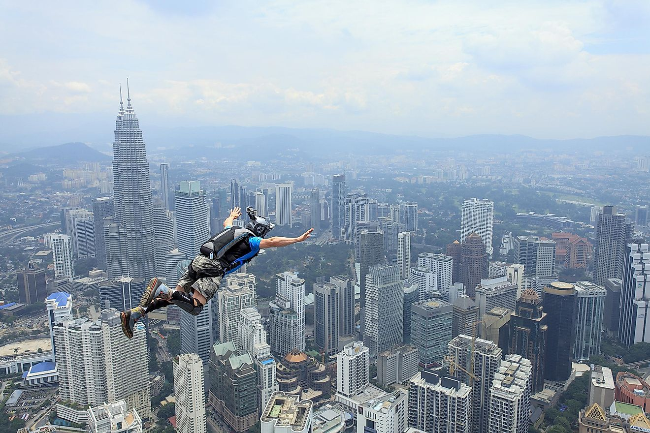 People like to climb and jump off significant buildings. Credit: Muslianshah Masrie / Shutterstock.com