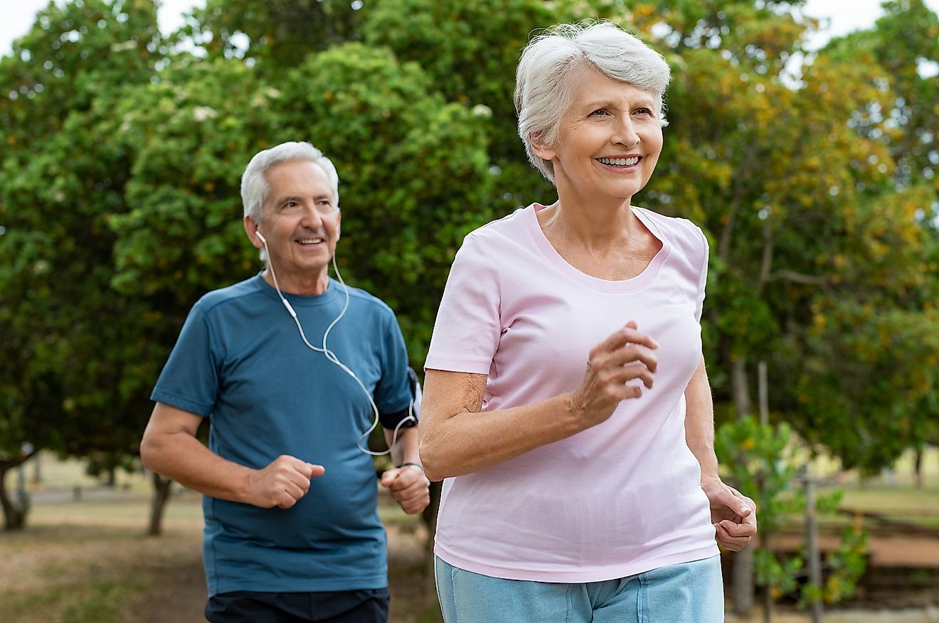 An aged couple running to stay fit and healthy.