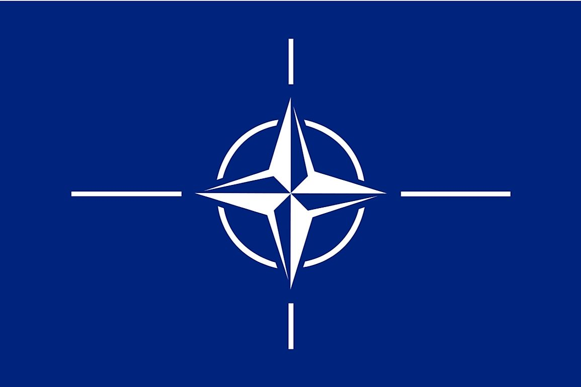 The NATO flag features a white compass rose.