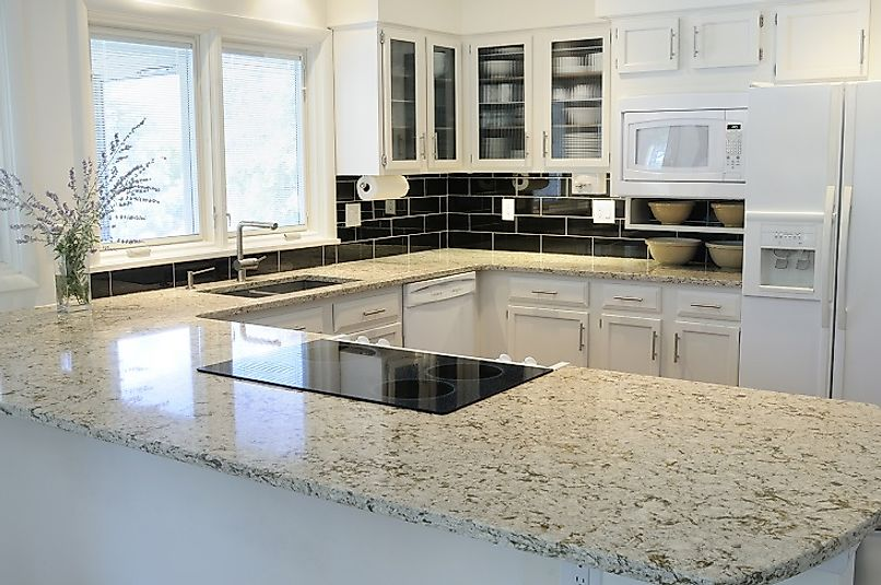 The beautiful granite countertops serve as the centerpiece of this kitchen.