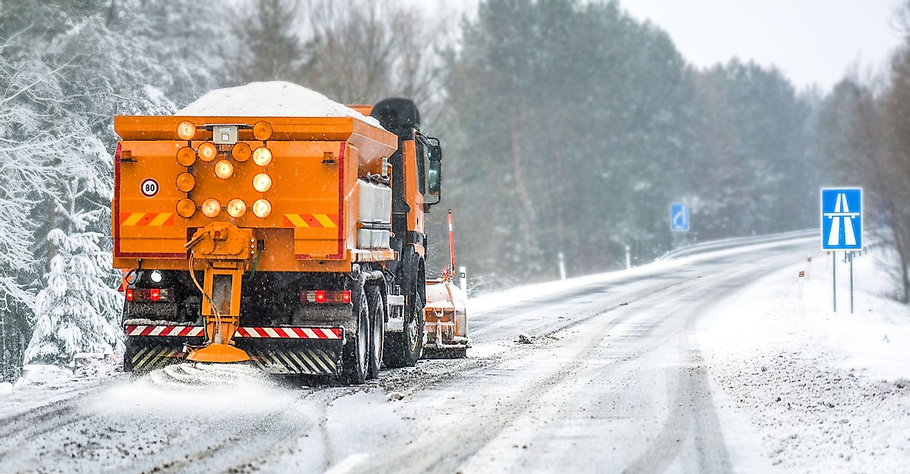 Road salt being added on a highway by a truck. Image credit: Krasula/Shutterstock.com