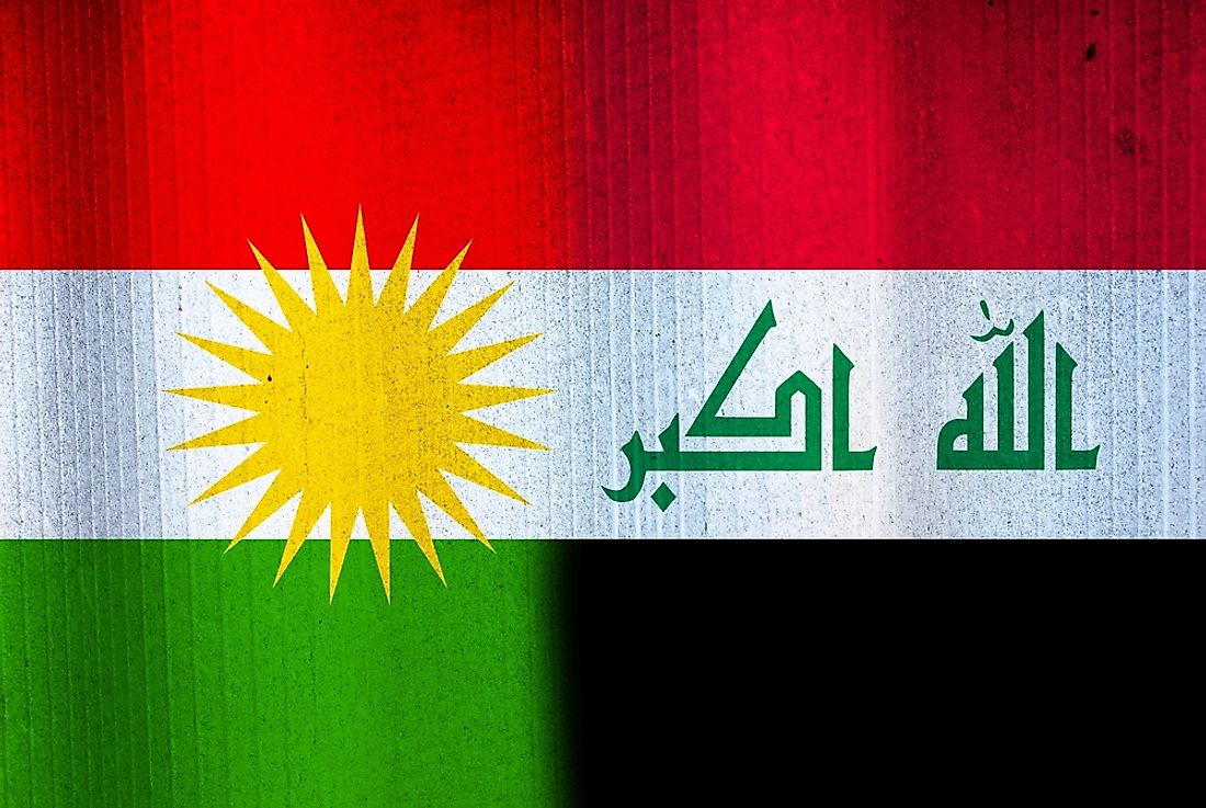 The flags of Iraq and Kurdistan.